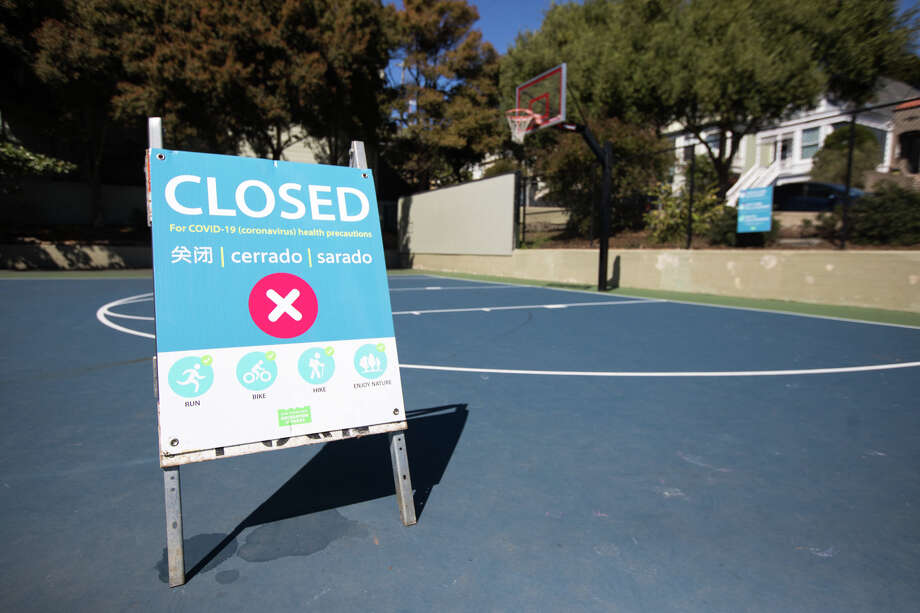Playgrounds and athletic courts in parks across San Francisco stand empty after enhanced restrictions closed them to the public. Photo: Douglas Zimmerman/SFGate