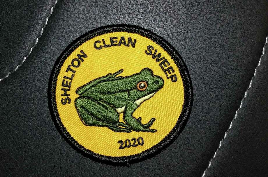 Residents who pick up litter this month can get this Green Frog patch. The frog is designed after city conservation agent Teresa Gallagher's daughter's pet frog, Chadd. Photo: Contributed Photo / Connecticut Post