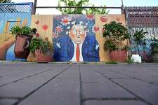 TOPSHOT - A mural painted on a fence depicts US President Donald Trump as the Coronavirus in San Francisco, California on April, 01, 2020. - All 40 million residents of California were Thursday ordered to stay at home indefinitely in a bid to battle the coronavirus pandemic in the nation's most populous state. (Photo by Josh Edelson / AFP) (Photo by JOSH EDELSON/AFP via Getty Images)