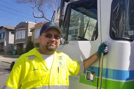 Recology of San Francisco garbage collector Aaron Meier works his route in the city's Richmond District. Meier tweeted a message of hope and perseverance for San Francisco in the first week of the coronavirus crisis. It was liked more than 500,000 times.