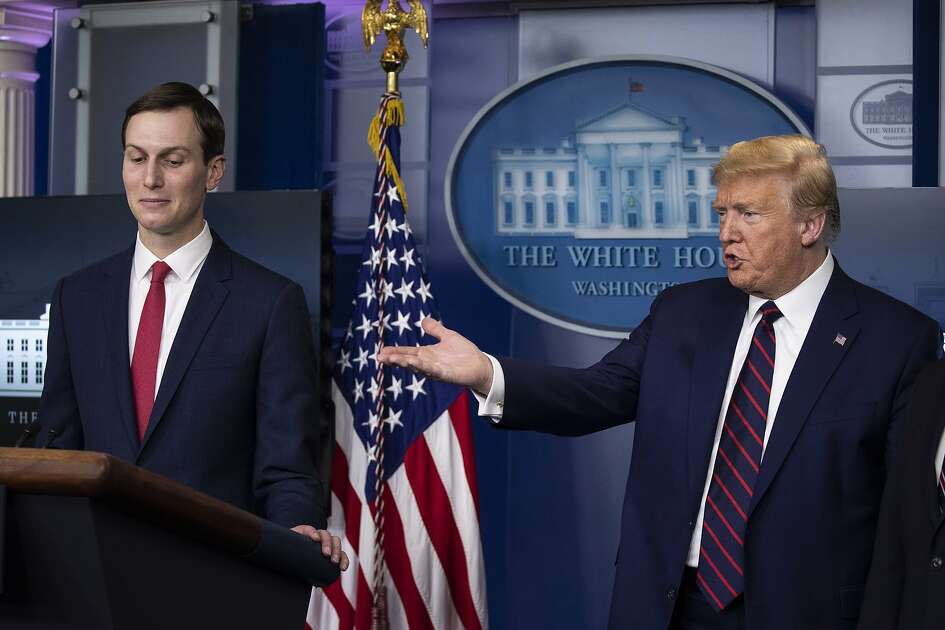 President Donald Trump, right, gestures towards White House adviser Jared Kushner, as he speaks about the coronavirus in the James Brady Press Briefing Room of the White House, Thursday, April 2, 2020, in Washington. (AP Photo/Alex Brandon)