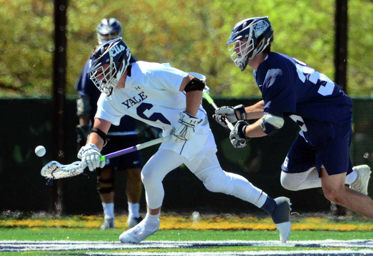 Yale's TD Ierlan (6) scoops up the ball as Georgetown's James Reilly (33) chases during the First Round of NCAA Division I Men's Lacrosse Championship action in New Haven, Conn., on Saturday May 11, 2019.