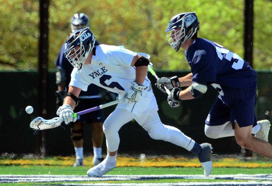 Yale's TD Ierlan (6) scoops up the ball as Georgetown's James Reilly (33) chases during the First Round of NCAA Division I Men's Lacrosse Championship action in New Haven, Conn., on Saturday May 11, 2019. Photo: Christian Abraham / Hearst Connecticut Media / Connecticut Post