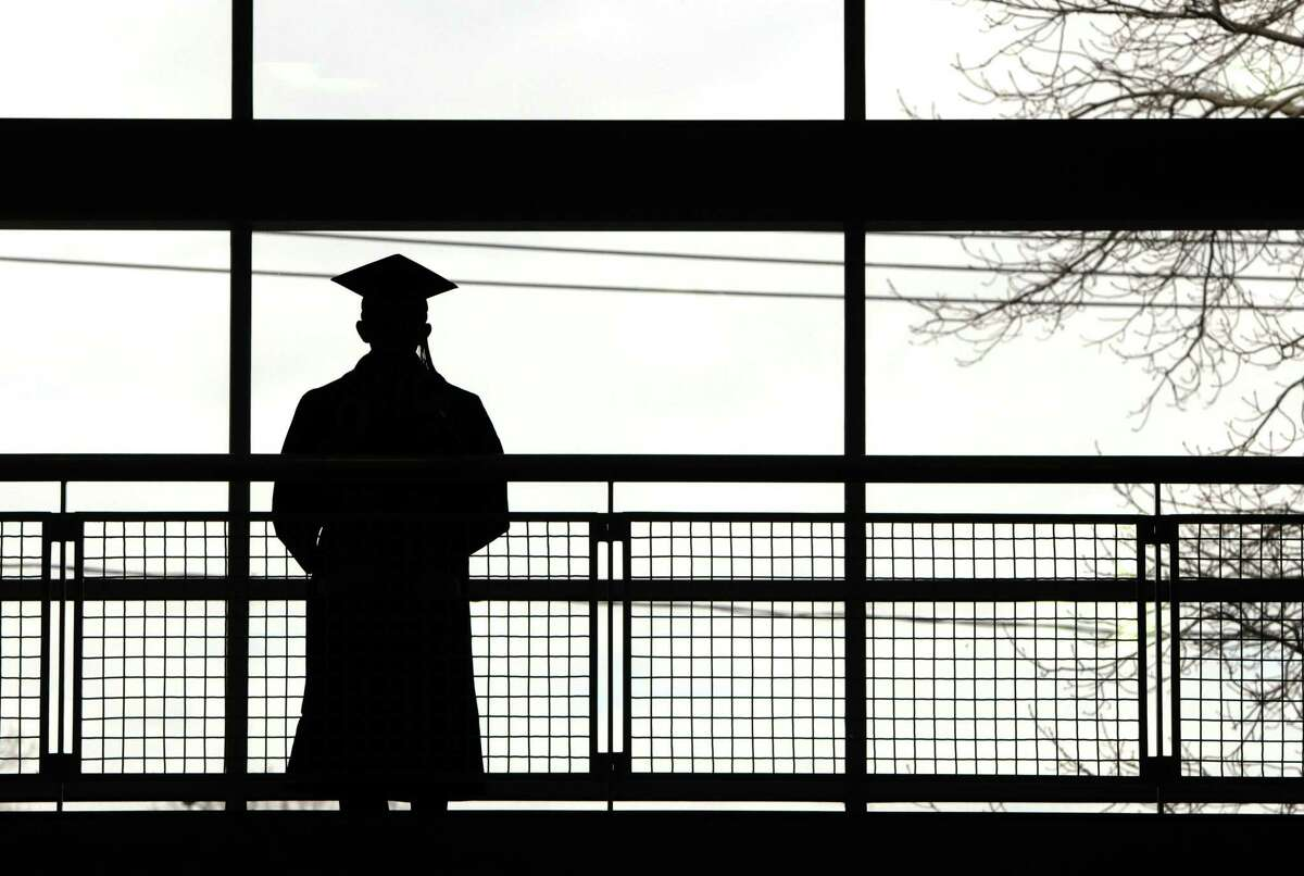 In this file photo, a University of New Haven students looks out before the start of the University of New Haven 2013 Winter Commencement ceremony at the university's David A. Beckerman Recreation Center in West Haven, Conn.