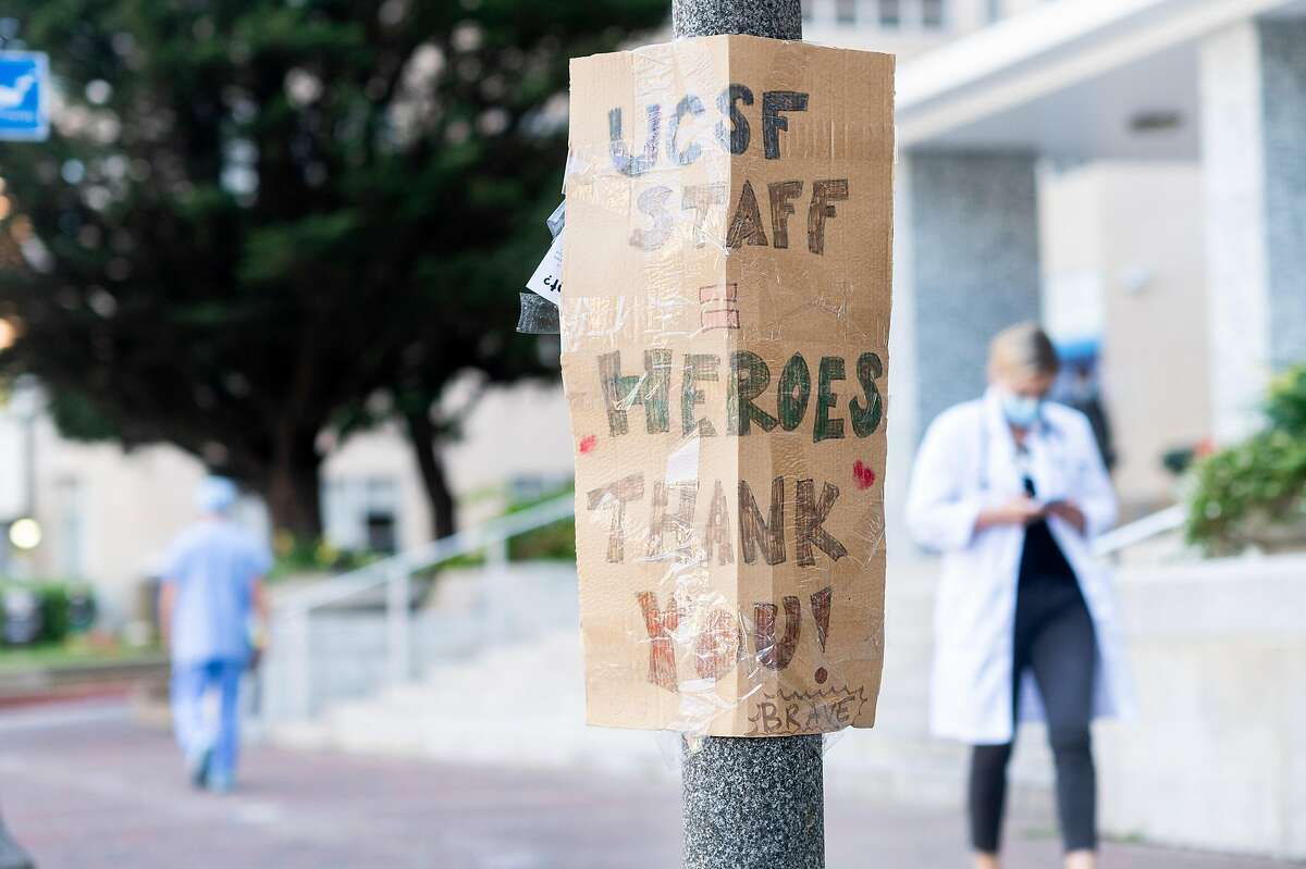 A sigs thanking UCSF staff hangs outside the university's Parnassus Ave. medical center on Friday, April 3, 2020, in San Francisco. UCSF physicians are using Twitter to help educate the public about the frightening and evolving coronavirus outbreak.