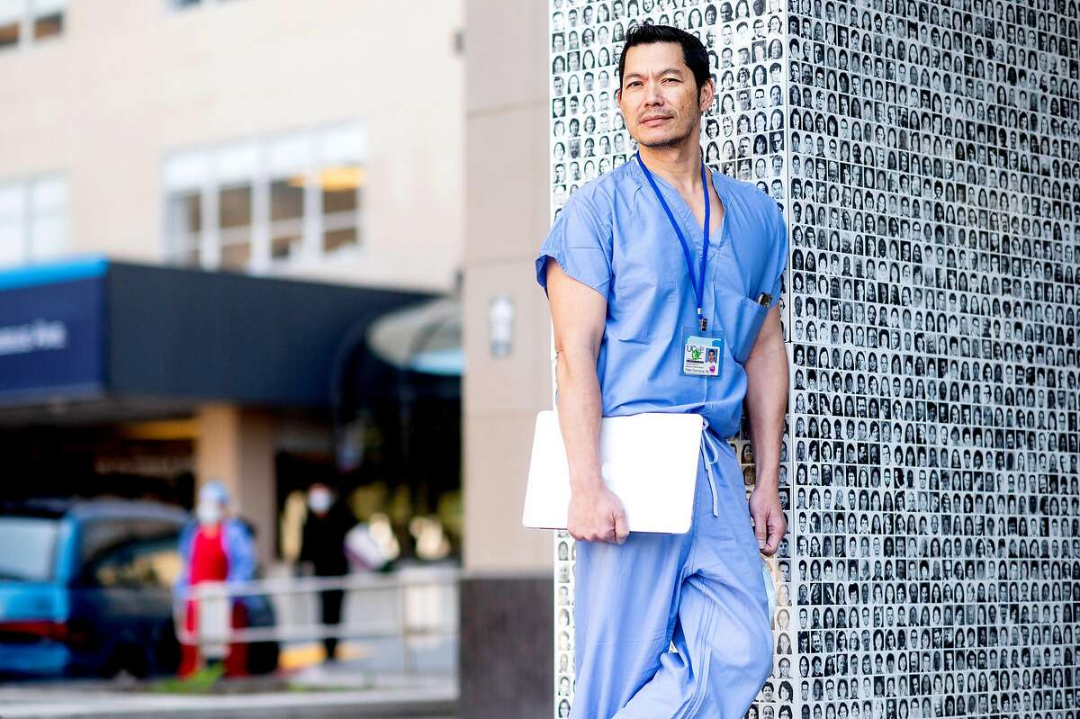 Dr. Peter Chin-Hong stands outside UCSF Medical Center on Friday, April 3, 2020, in San Francisco. Dr. Chin-Hong and fellow UCSF physicians are using Twitter to help educate the public about the frightening and evolving coronavirus outbreak.