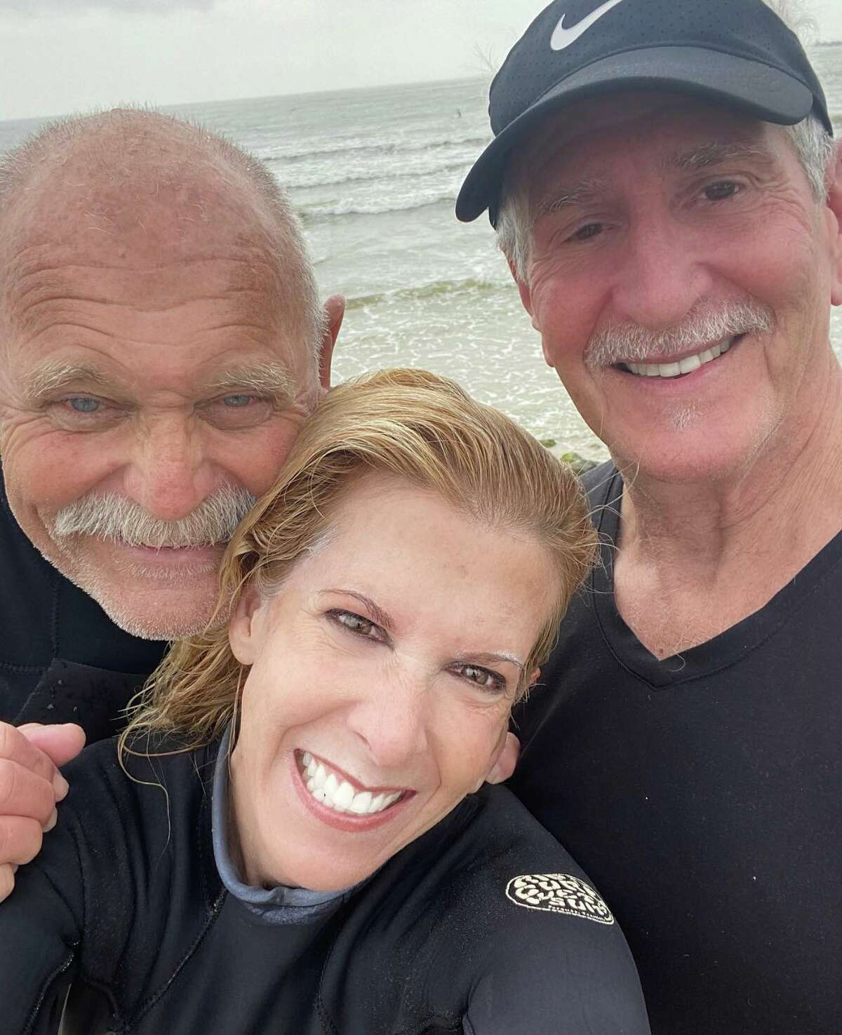 These are some of Marisa's trusted Texas surf buddies. She surfed with them for the last time at Surfside right before she went into quarantine.