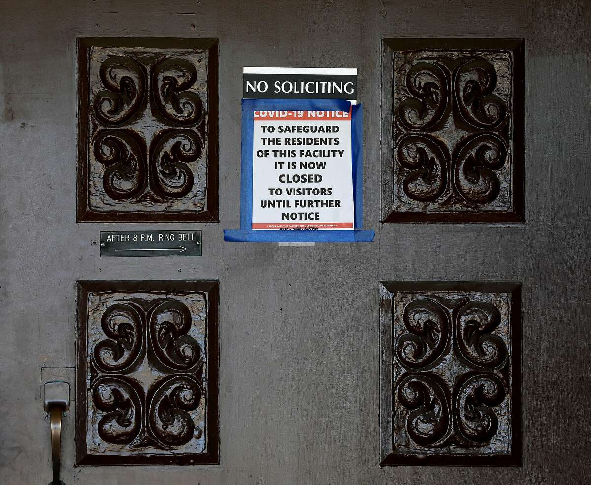 """A COVID-19 notice has been posted on the front door at the Orinda Care Center, located at 11 Altarinda Rd., on Friday, April 3, 2020, in Orinda, Calif. The post states, """"To safeguard the residents of this facility, it is now closed to visitors until further notice."""" Contra Costa officials release more info on outbreak at nursing facility, launch investigations into two more facilities: At least 27 people who live or work at a 45-resident nursing facility in Orinda have tested positive for the coronavirus, health officials said Friday as they launched investigations and started testing at two other senior care facilities in the county. Officials started investigating the Orinda Care Center this week when two staffers sought sought medical care, according to the county Health Services. The two staffers and two patients tested positive on Wednesday. County health officials tested all patients and staff Thursday, they said, and confirmed 24 patients and three staffers had the virus. They are still awaiting some test results. Two of the residents are being treated at hospitals. As of Friday morning, no staffers or patients had died of the virus. Staffers and residents who do not have serious symptoms are medically isolated but not hospitalized, officials said. """"The situation is very serious, and we are deeply concerned about residents of our senior care facilities in Contra Costa County,"""" said Dr. Chris Farnitano, the county's health officer. """"That is why we need everyone to follow the stay-at-home order, social distancing guidance and other measures in recent health orders ? to protect the people in our community who are vulnerable to severe illness from COVID-19."""""""