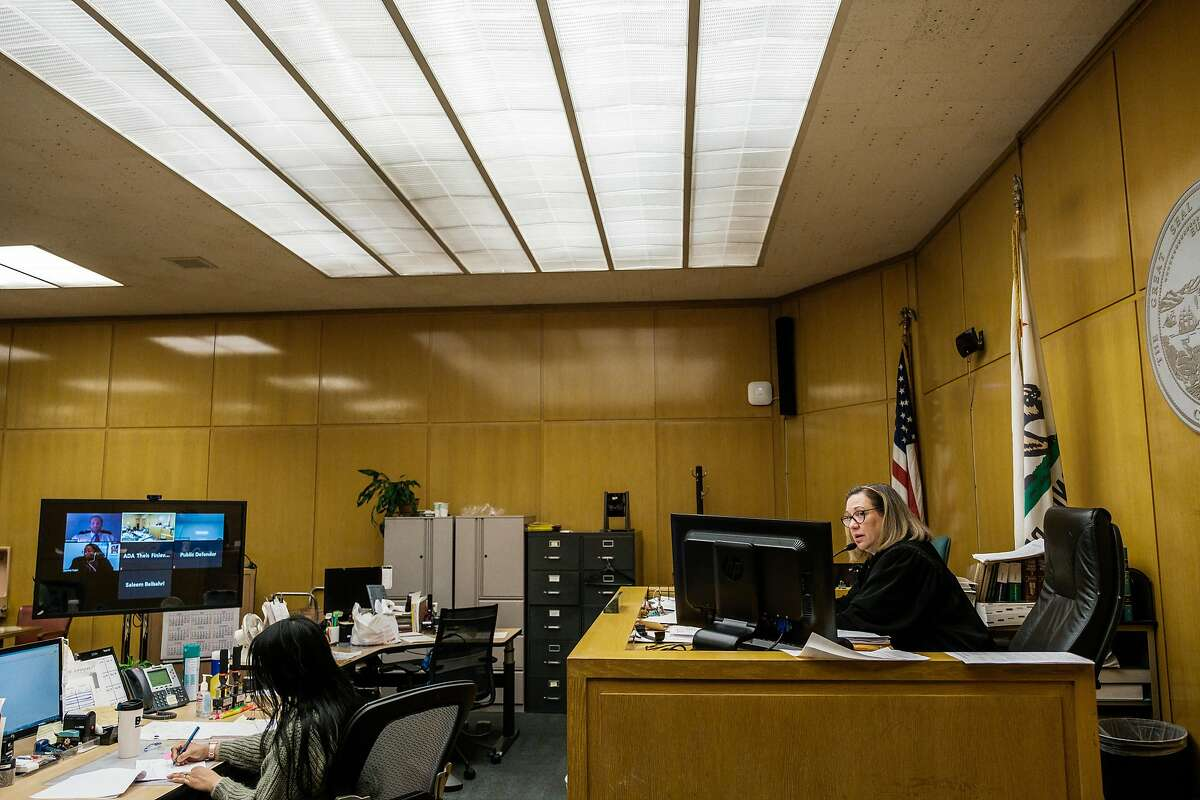 Judge Loretta Giorgi presides over court cases while other officers of the court contribute remotely in San Francisco, Calif. on Friday April 3, 2020.