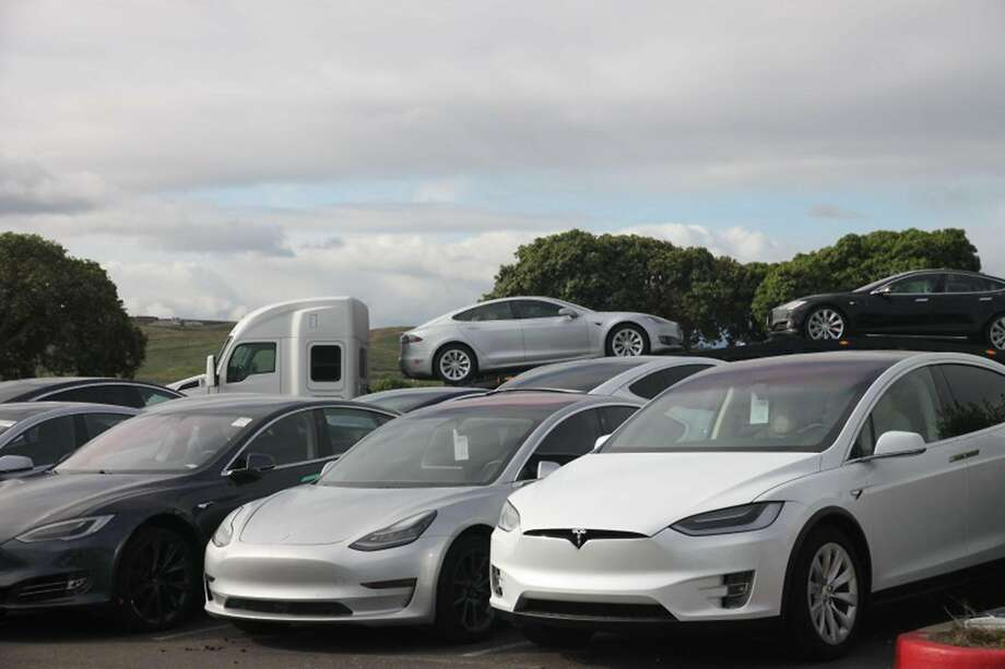 Tesla vehicles are parked outside a delivery center in Fremont last month. The company had been on its way to a third strong quarter. Photo: Russ Mitchell / Los Angeles Times