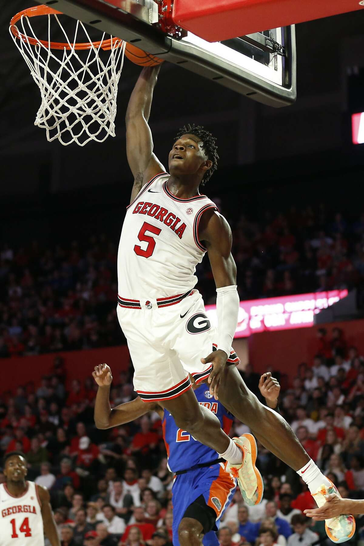 FILE - In this March 4, 2020, file photo, Georgia's Anthony Edwards dunks against Florida during an NCAA college basketball game in Athens, Ga. Edwards was selected to the Associated Press All-SEC first team announced Tuesday, March 10, 2020. Edwards was also named the AP SEC Newcomer of the Year. (Joshua L. Jones/Athens Banner-Herald via AP, File)