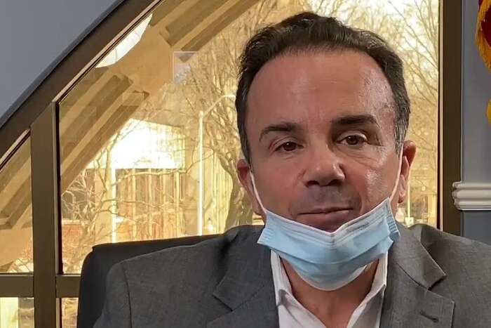 Bridgeport Mayor Joe Ganim dons a mask during his Thursday briefing on Facebook Live. The city is handing out masks to residents and Ganim is encouraging city residents to wear them.
