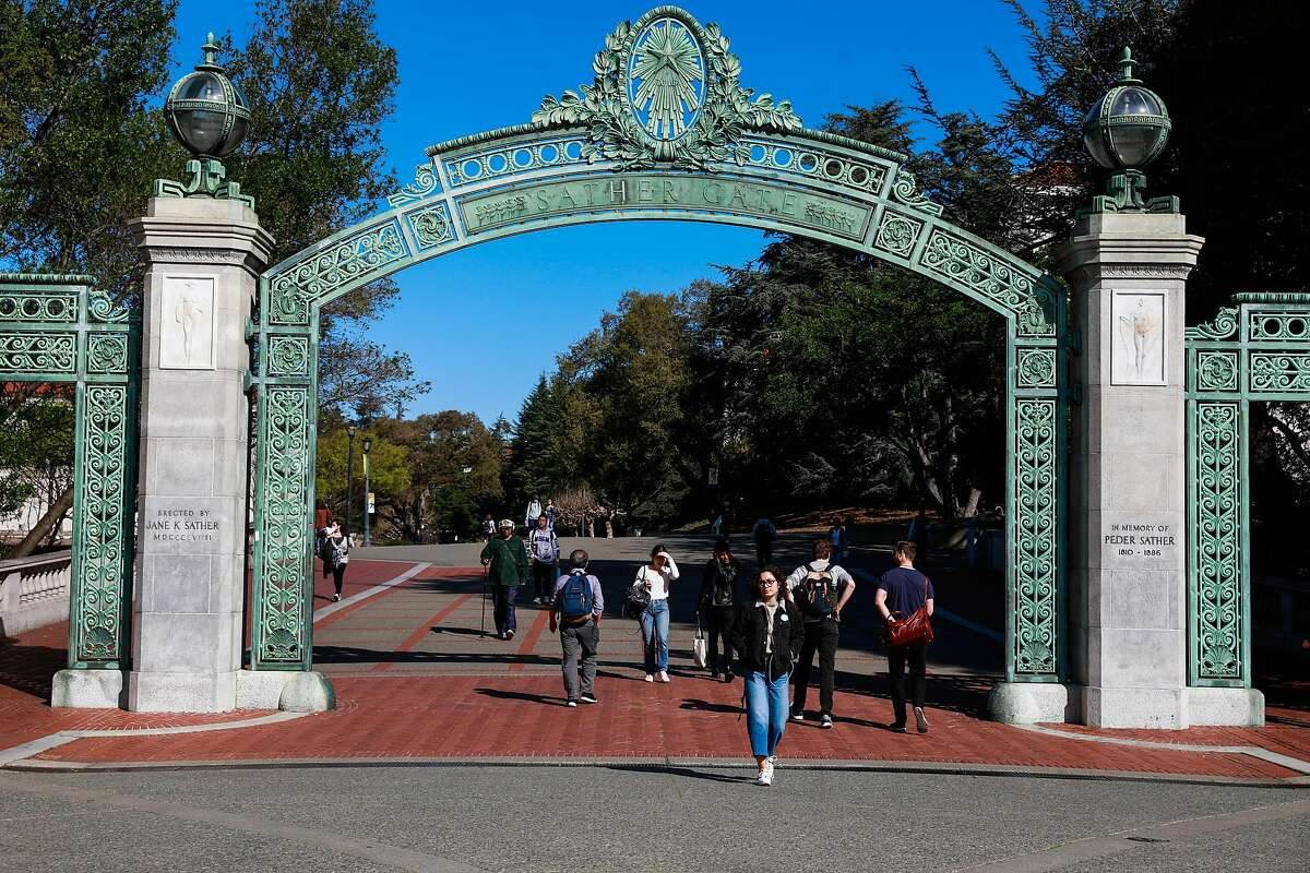 People walk through the UC Berkeley campus a day after Berkeley suspended in-person classes through the end of Spring break due to the coronavirus on Tuesday, March 10, 2020 in Berkeley, California.