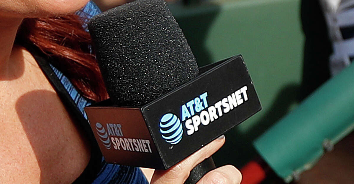 Julia Morales, field reporter and host for AT&T SportsNet reports from inside the third base photo well in the sixth inning of an MLB baseball game at Globe Life Park, Saturday, March 31, 2018, in Arlington. ( Karen Warren / Houston Chronicle )