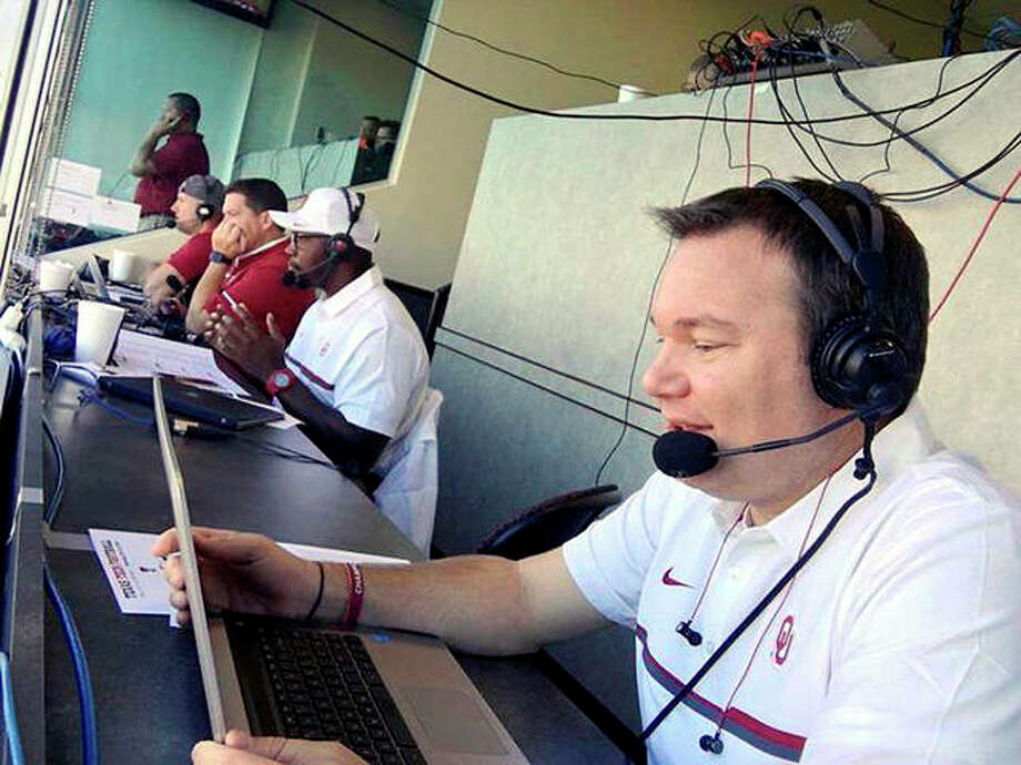 Wood River native Chris Plank works in the press box during an Oklahoma football broadcast in Lubbock, Texas. Plank is the voice of Sooner softball and a sideline reporter for OU football games. Photo: Submitted Photo