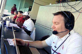 Wood River native Chris Plank works in the press box during an Oklahoma football broadcast in Lubbock, Texas. Plank is the voice of Sooner softball and a sideline reporter for OU football games.