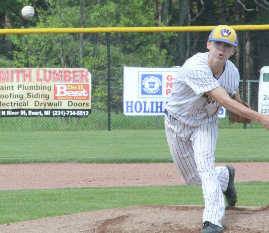 Evart's Danny Witbeck fires a pitch to the plate following action last season. (Pioneer file photo)