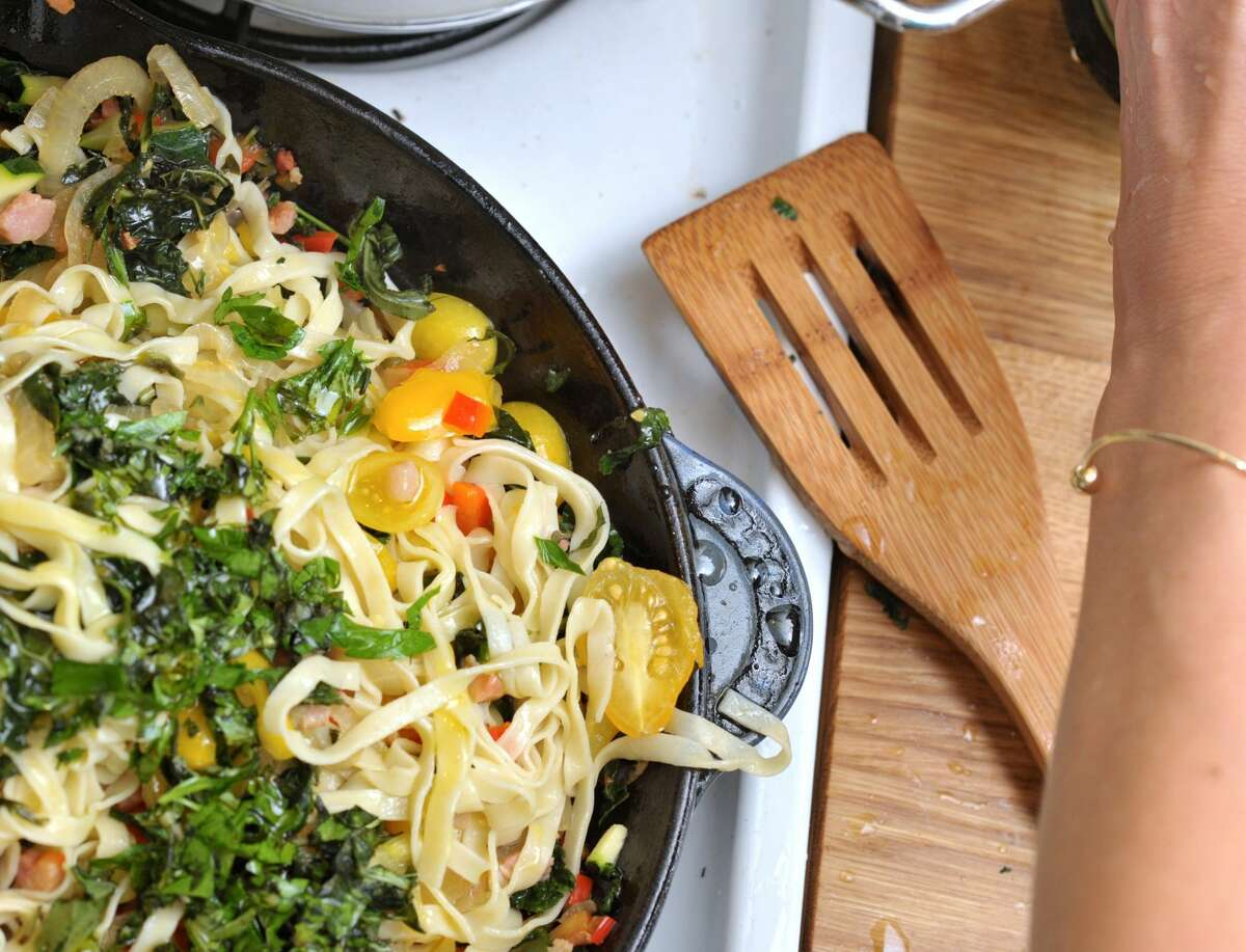 The Heirloom Chef is a Bay Area company that offers locals a menu created by personal chefs. The staff prepare dishes for individuals that have dietary restrictions. Pictured is a gluten-free pasta with heirloom tomatoes and kale.