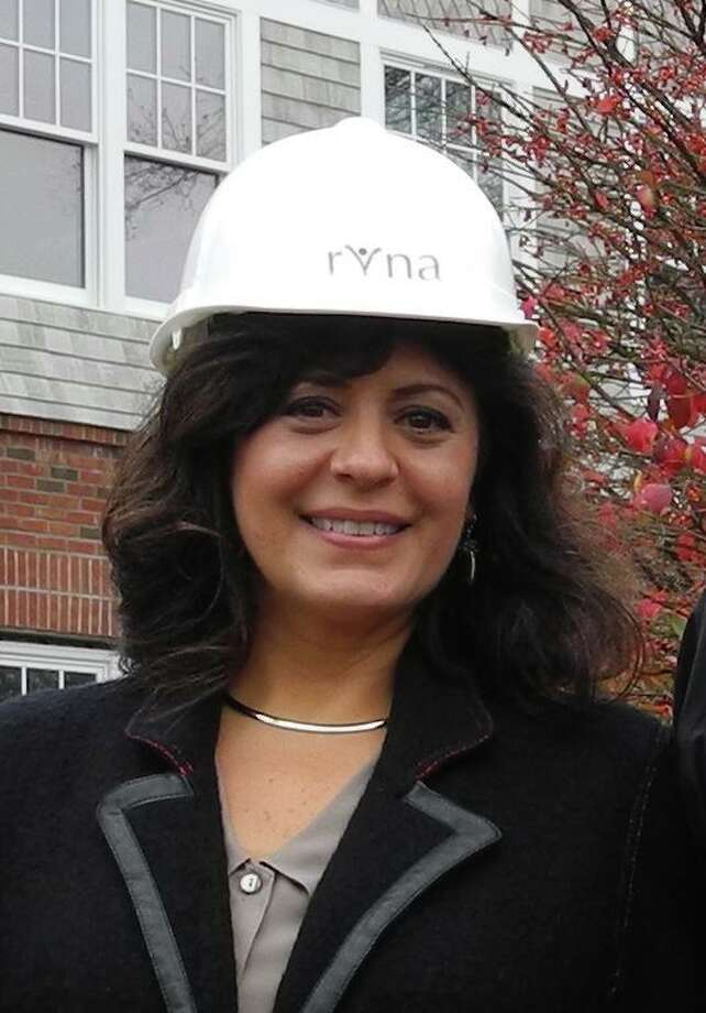 Theresa Santoro leads the RVNA, which serves 28 Connecticut towns. She donned a hard has in 2015 when giving a tour of group's headquarters, then still under-construction in Ridgefield. Photo: Macklin Reid / Hearst Connecticut Media