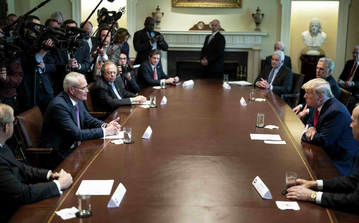 Darren Woods, chairman and chief executive officer of Exxon Mobil Corp., center left, speaks as President Donald Trump, center right, listens during a roundtable meeting with energy sector chief executive officers in the Cabinet Room of the White House, So far, Trump's efforts to boost the struggling oil and gas industry have not paid off.