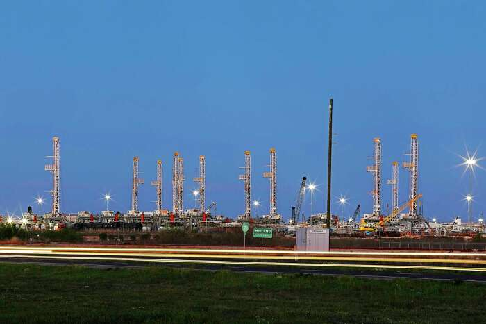 Oil rigs are stored near Midland. The number of operating rigs in the U.S. declined by 9 percent this week.
