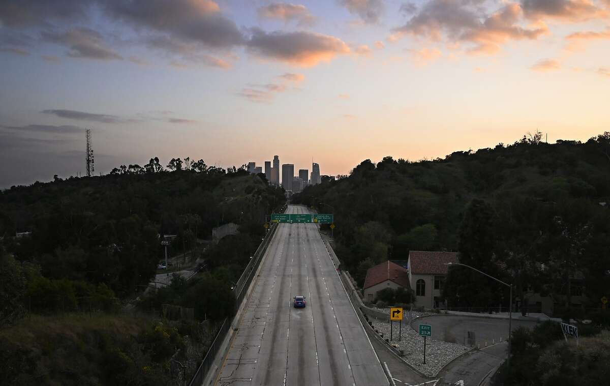 Few cars occupy the Arroyo Seco Parkway toward downtown Los Angeles during rush hour, Thursday, April 2, 2020, in Los Angeles, during the coronavirus pandemic. (AP Photo/Mark J. Terrill)