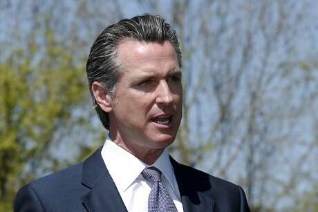 Gov. Gavin Newsom discuses California's efforts to convert hotels and motels into isolation housing for the homeless threatened by the coronavirus during a news conference near Sacramento, Calif. April 3, 2020. Newsom spoke about the partnership with the Federal Emergency Management Agency to cover some costs outside a recently converted motel.(AP Photo/Rich Pedroncelli, Pool)
