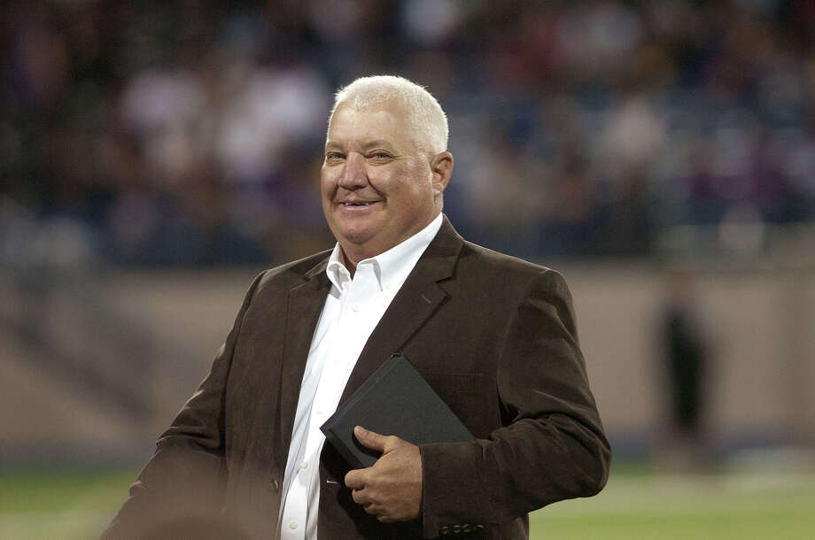 Former Lee football coach John Parchman walks off the field after being recognized as one of MISD Hall of Legends inductees in 2010 at Grande Communications Stadium Photo: MRT File Photo