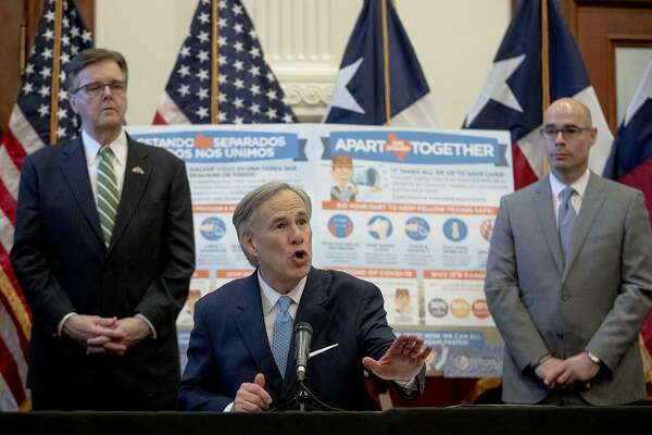 Texas Gov. Greg Abbott, flanked by Lt. Gov. Dan Patrick, left, and House Speaker Dennis Bonnen, speaks during a Capitol news conference about the state's response to the coronavirus. (Nick Wagner/Austin American-Statesman/TNS)