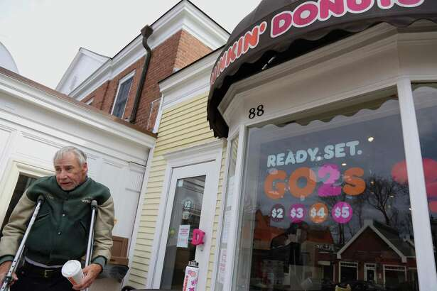 """Dan Dobbins of South Salem, New York stands outside of the Dunkin' (Donuts) location in New Canaan recently. The New Canaan Tourism and Economic Development and Advisory Committee, (TEDAC), has composed this written piece to """"remind everybody that while we protect our families in the midst of this war on COVID-19, it is critical to help our business community survive and thrive while we protect our families."""""""
