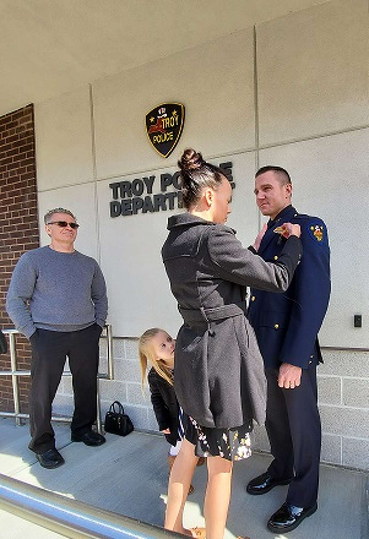 On Wednesday, March 18, in an outdoor ceremony, Troy Police Officer Christopher Rasmussen was promoted to the rank of sergeant with the oath administered by Mayor Patrick Madden. Rasmussen's family attended, including his wife Lindsay, daughter Natalie and his parents. Many other department members looked on from afar and joined in a round of applause. Rasmussen has been a member of the department since July 2007 and has been assigned to the Patrol Division. He is also a field training officer and has received a number of training certifications throughout his career.