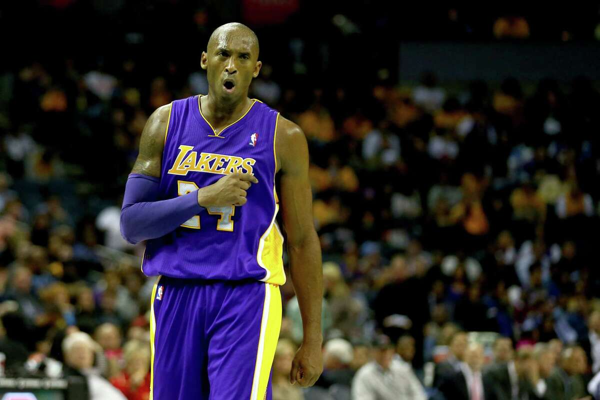 CHARLOTTE, NC - DECEMBER 14: Kobe Bryant #24 of the Los Angeles Lakers reacts after a call during their game against the Charlotte Bobcats at Time Warner Cable Arena on December 14, 2013 in Charlotte, North Carolina. NOTE TO USER: User expressly acknowledges and agrees that, by downloading and or using this photograph, User is consenting to the terms and conditions of the Getty Images License Agreement. (Photo by Streeter Lecka/Getty Images)