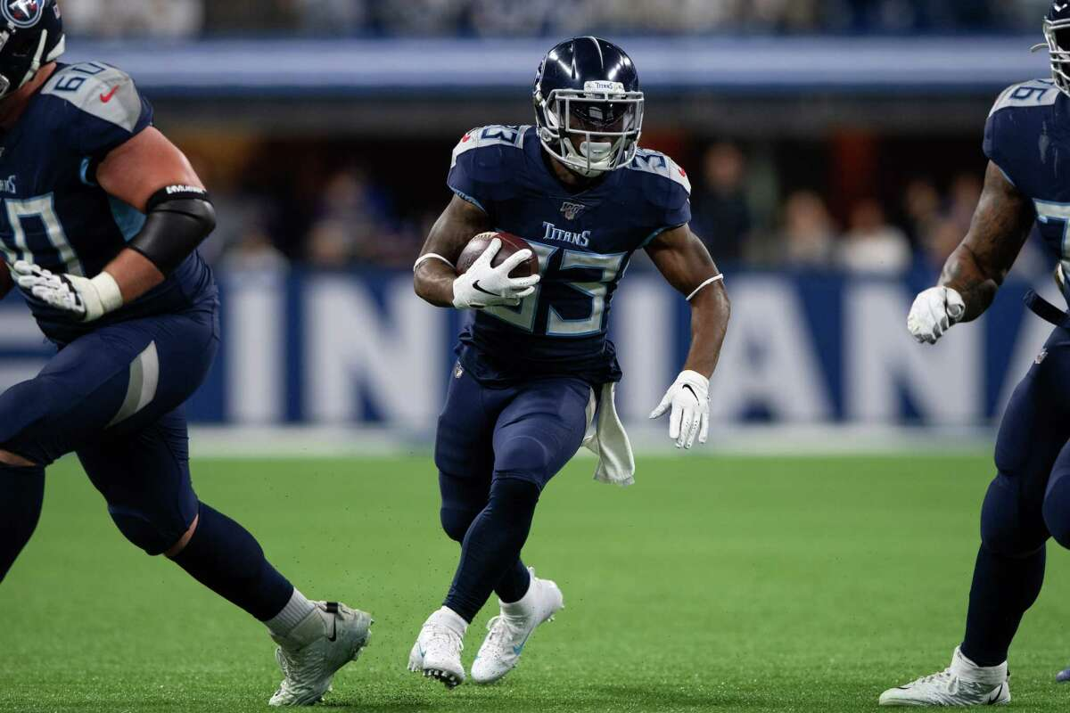 INDIANAPOLIS, IN - DECEMBER 01: Tennessee Titans running back Dion Lewis (33) runs through a hole in the line during the NFL game between the Tennessee Titans and the Indianapolis Colts on December 1, 2019 at Lucas Oil Stadium, in Indianapolis, IN. (Photo by Zach Bolinger/Icon Sportswire via Getty Images)