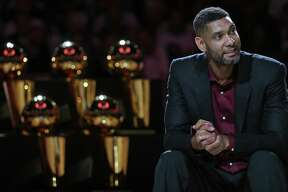 Former San Antonio Spurs player Tim Duncan listens to speakers during his jersey retirement ceremony held after the game with the New Orleans Pelicans Sunday Dec. 18, 2016 at the AT&T Center.