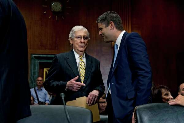 """FILE a€?"""" Senate Majority Leader Mitch McConnell (R-Ky.) speaks with Judge Justin Walker during a Senate hearing for several judicial nominations, on Capitol Hill in Washington, July 31, 2019. Walker, a McConnell protA©gA©, has been nominated by President Donald Trump for the influential United States Court of Appeals for the District of Columbia Circuit, touching off what is likely to be a contentious confirmation fight in the Senate. (Anna Moneymaker/The New York Times)"""