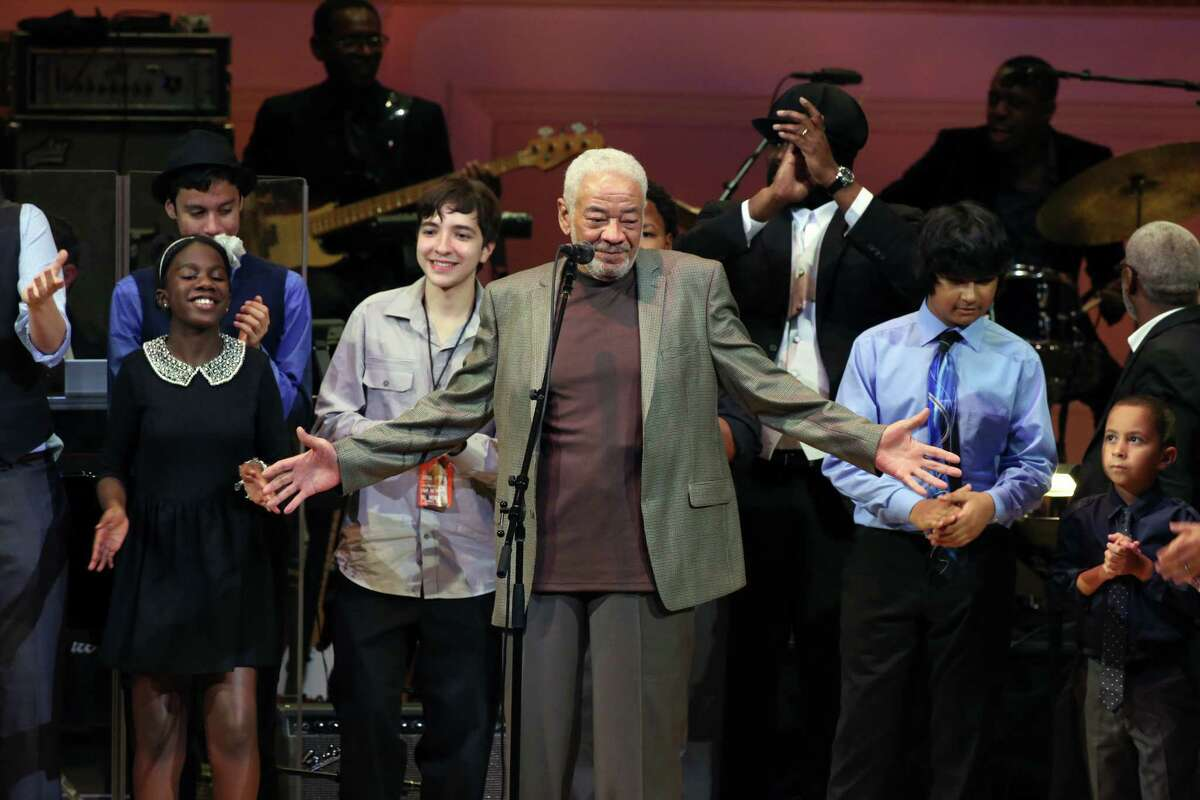 """FILE -- Bill Withers onstage during a tribute concert featuring his music at Carnegie Hall in New York on Oct. 1, 2015. Withers, the legendary soul singer behind 1970s hits like """"Lean on Me,"""" """"Lovely Day"""" and """"Aina€™t No Sunshine,"""" died on Monday, March 30, 2020, in Los Angeles, his family said. He was 81. (Michelle V. Agins/The New York Times)"""