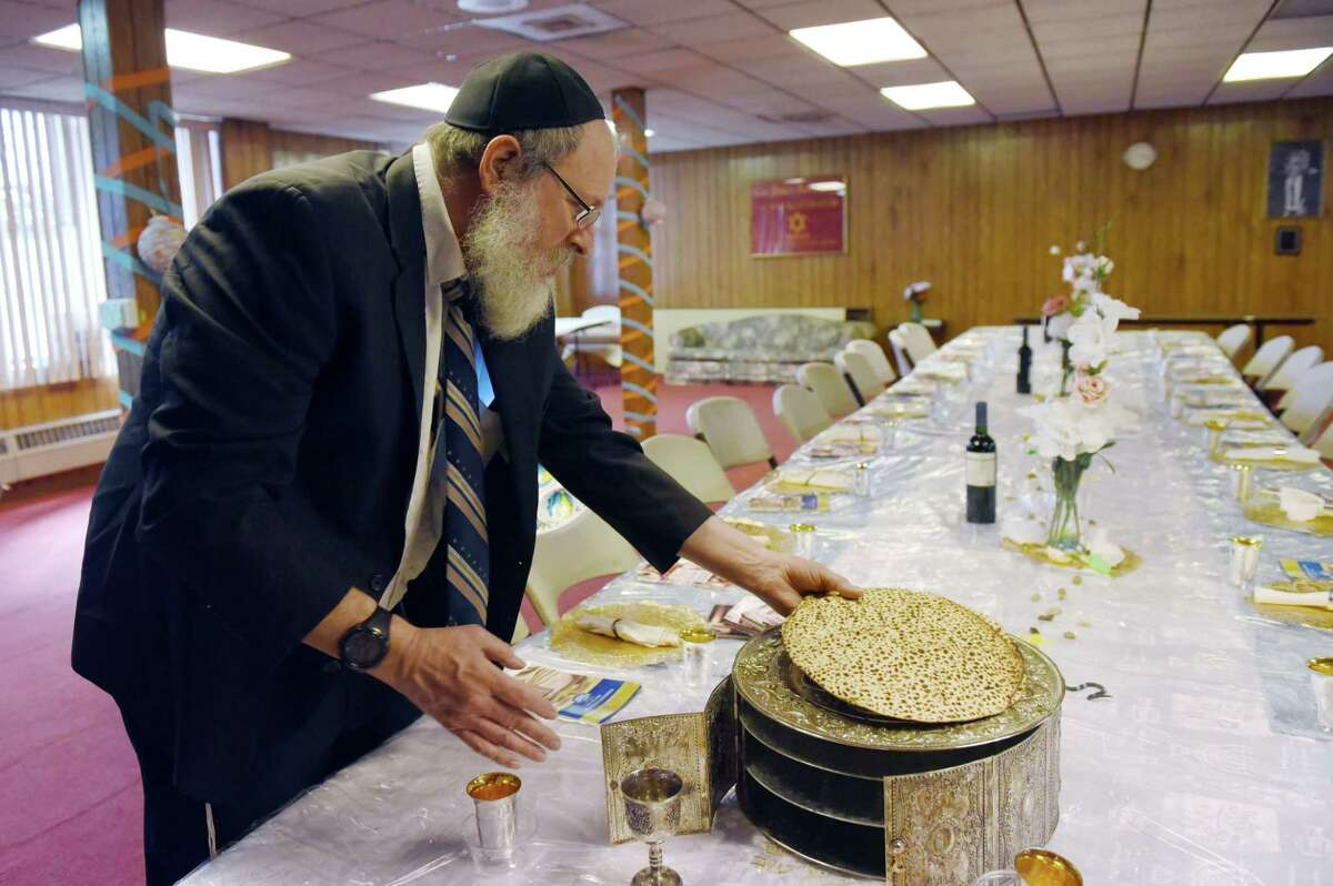 Leible Morrison talks about the hand-made matzah from Brooklyn that will be served for Passover on Wednesday, April 17, 2019 at the Beth Tephilah Synagogue in Troy, NY. (Phoebe Sheehan/Times Union)