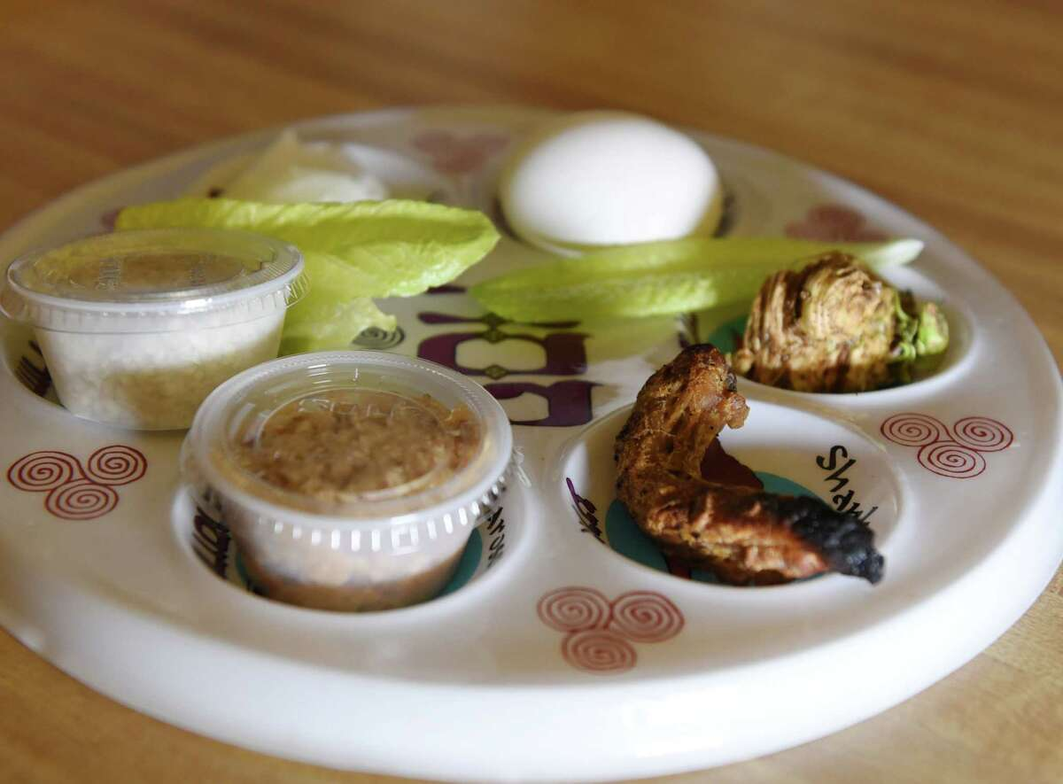 The Seder plate is prepared on Friday, April 19, 2019 at the Shabbos House in Albany, NY. (Phoebe Sheehan/Times Union)