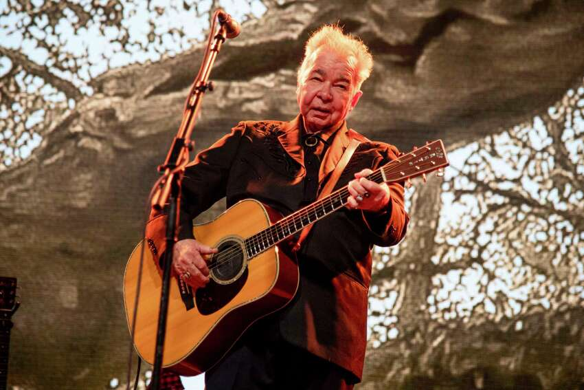 FILE - This June 15, 2019 file photo shows John Prine performing at the Bonnaroo Music and Arts Festival in Manchester, Tenn. The family of John Prine says the singer-songwriter is critically ill and has been placed on a ventilator while being treated for COVID-19-type symptoms. A message posted on Prine's Twitter page Sunday, March 29, 2020 said the a€œAngel from Montgomerya€ singer has been hospitalized since Thursday and his condition worsened on Saturday. (Photo by Amy Harris/Invision/AP, File)