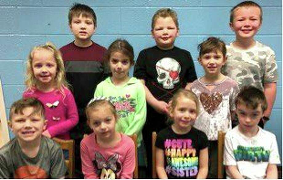 Bad Axe Elementary School students named Students of the Month are (front row) Young 5s and Kindergarten: Ethan Talaski, Alexa Ahearn, Ella Messing and Benjamin Morell; (second row) Grade 1: Kennedy Grekowicz, Elle Rifenbark and Macee Aymen; (third row) Grade 2: Wyatt Hass and Logan Hiller; Physical Education - Fisher Corbishley. Student missing from second grade is Kinley Schramski. (Submitted Photo)