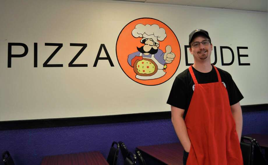 George Prokop poses for a photo at his Midland-based Pizza Dude restaurant, located at4328 N. Saginaw Road. He is now the sole owner of the Pizza Dude franchise. (Ashley Schafer/Ashley.Schafer@hearstnp.com)