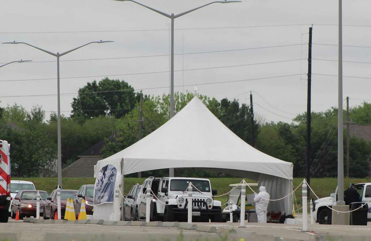 Hundreds of cars lined up at a free COVID-19 testing site operated by United Memorial Medical Center outside Sugar Land's Smart Financial Center on Friday, April 3.