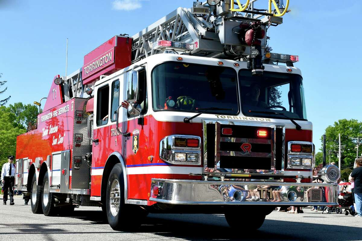 The Torrington Fire Department contained a fully involved garage blaze Sunday morning before it reached the adjacent home.
