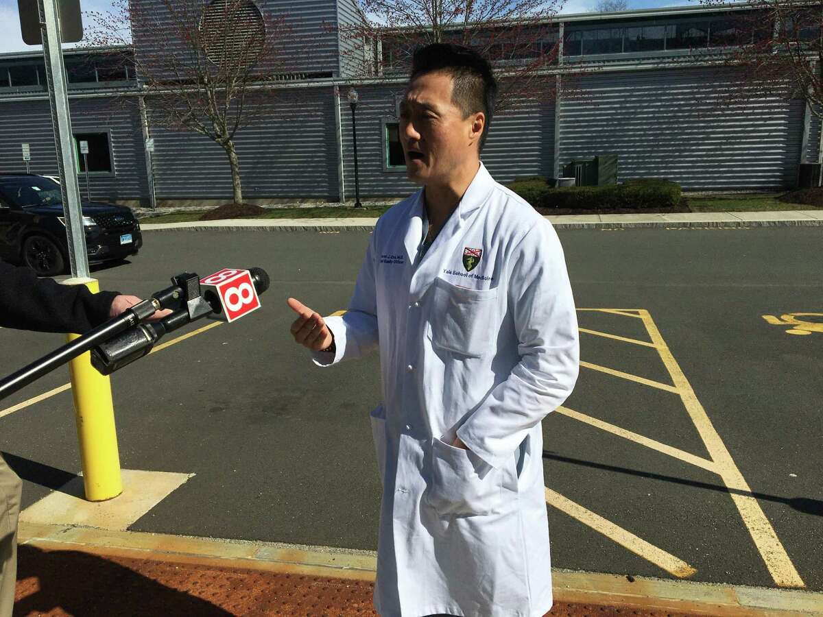 Dr. Steven Chou, of the Yale School of Medicine at Southern Connecticut State University on Wednesday after CT National Guard troops set up a 200-bed field hospital in the campus gymnasium.