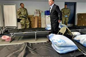 Gov. Ned Lamont tours a Federal Emergency Management Agency 250-bed medical field hospital Wednesday for non-coronavirus patients in the Southern Connecticut State University Moore Field House in New Haven staged by members of the Connecticut National Guard's 1-102nd Infantry. The site is intended to treat non-COVID-19 patients so there will be more hospital beds people who are impacted by COVID-19.