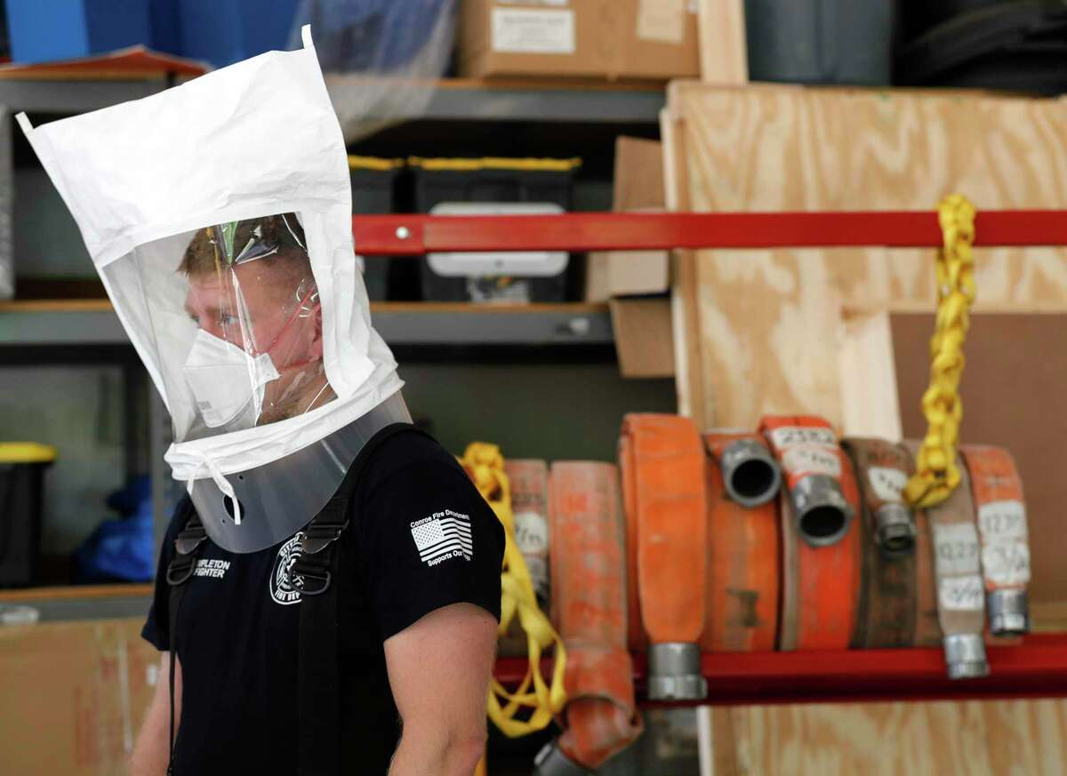 Conroe firefighter Josh Templeton goes through the fitting process as firefighters are issued 3M N95 mask, Tuesday, March 31, 2020, in Conroe.