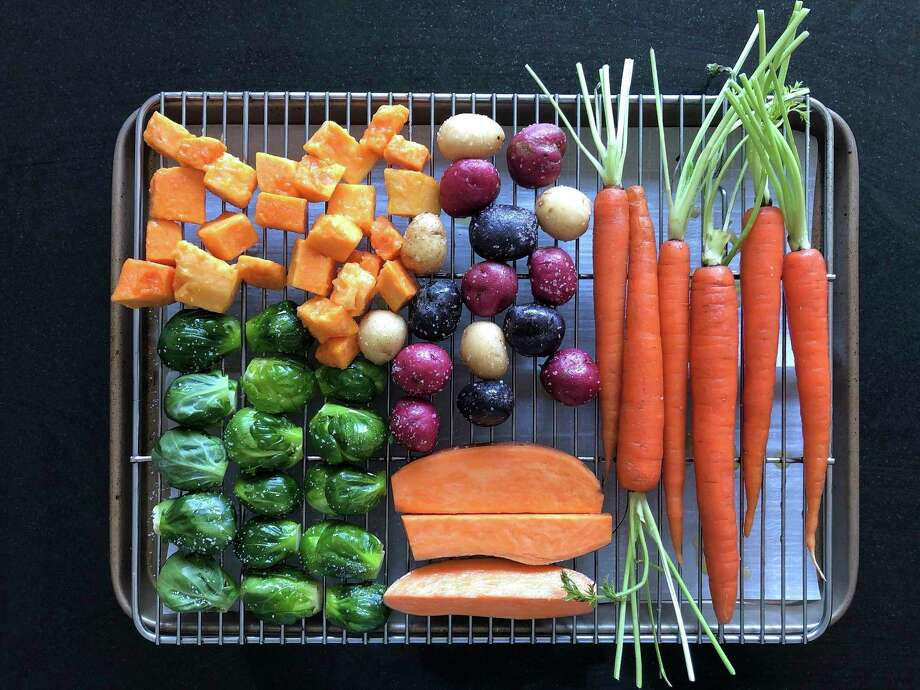 This March 2, 2020 image shows various vegetables placed on a rack prior to roasting in Amagansett, N.Y. The key to roasting and grilling is having the natural sugars in the vegetables browned and caramelized, resulting in both great texture and flavor. (Elizabeth Karmel via AP) / Elizabeth Karmel