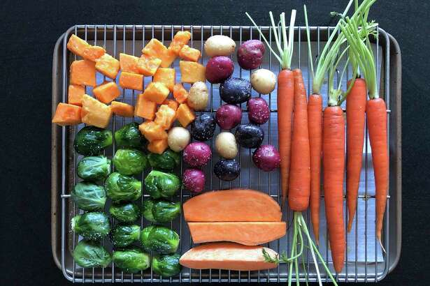 This March 2, 2020 image shows various vegetables placed on a rack prior to roasting in Amagansett, N.Y. The key to roasting and grilling is having the natural sugars in the vegetables browned and caramelized, resulting in both great texture and flavor. (Elizabeth Karmel via AP)