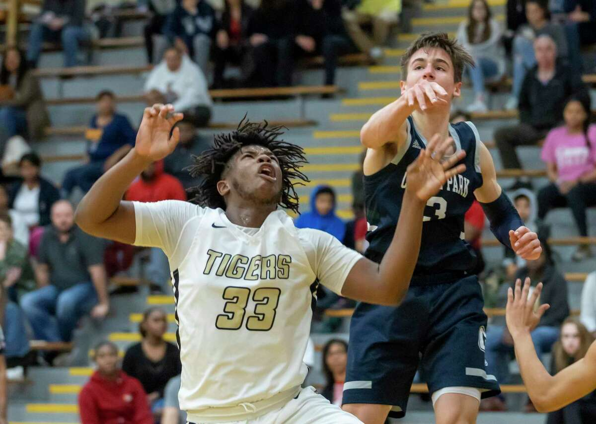 Conroe forward Kamari Weatherspoon (33) is one of the top players for the Tigers.