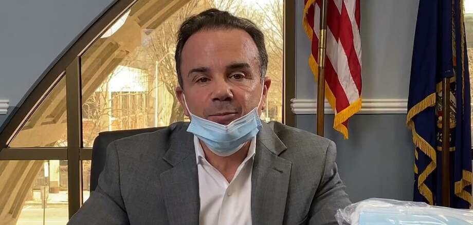 Bridgeport Mayor Joe Ganim dons a mask during his briefing on Facebook Live. Photo: Contributed /Mayor Joe Ganim's Facebook Page /